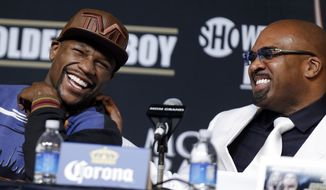 Boxer Floyd Mayweather Jr., left, and Mayweather Promotions CEO Leonard Ellerbe, laugh during a news conference Wednesday, April 30, 2014, in Las Vegas. Mayweather will face Marcos Maidana in a welterweight title fight on Saturday, May 3.  (AP Photo/Isaac Brekken)