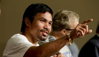 Boxer Manny Pacquiao, of the Philippines, talks during a news conference in Las Vegas, Tuesday, April 28, 2015. Floyd Mayweather Jr. and Manny Pacquiao are scheduled to fight May 2. (AP Photo/Chris Carlson)