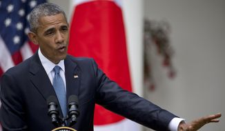 President Barack Obama speaks about recent unrest in Baltimore during his joint news conference with Japanese Prime Minister Shinzo Abe, Tuesday, April 28, 2015, in the Rose Garden of the White House in Washington. (AP Photo/Jacquelyn Martin)