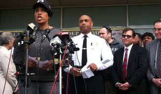 Baltimore Mayor Stephanie Rawlings-Blake, left, speaks at a news conference about the situation in Baltimore with Baltimore's Police Commissioner Anthony Batts, center, Tuesday, April 28, 2015. Baltimore was a city on edge as hundreds of National Guardsmen patrolled the streets against unrest for the first time since 1968, hoping to prevent another outbreak of rioting. (AP Photo/Jessica Gresko)