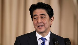Japanese Prime Minister Shinzo Abe speaks during a luncheon with Secretary of State John Kerry and Vice President Joe Biden, Tuesday, April 28, 2015,at the State Department in Washington. (AP Photo/Luis M. Alvarez)