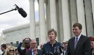 Civil rights lawyer Mary Bonautu, center, flanked by plaintiff James Obergefell of Ohio, left, and Washington attorney Douglas Hallward-Driemeier, right, speaks outside the Supreme Court in Washington, Tuesday , April 28, 2015, following a hearing on same-sex marriage. (AP Photo/Cliff Owen)