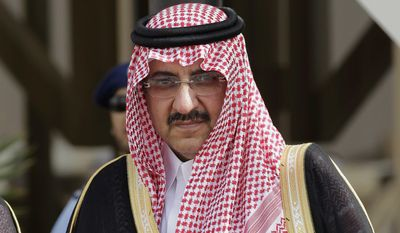 In this May 14, 2012, file photo, Saudi Arabia's Interior Minister Prince Mohammed bin Nayef waits for Gulf Arab leaders ahead of the opening of Gulf Cooperation Council, also known as GCC summit, in Riyadh, Saudi Arabia. (AP Photo/Hassan Ammar, File)