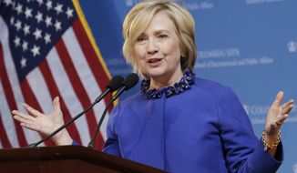 In this April 29, 2015, photo, Democratic presidential hopeful former Sen. Hillary Rodham Clinton speaks at the David N. Dinkins Leadership and Public Policy Forum in New York. Jeb Bush wants Republicans to know he's breaking fundraising records. Clinton wants Democrats to think she won't.  (AP Photo/Mark Lennihan)