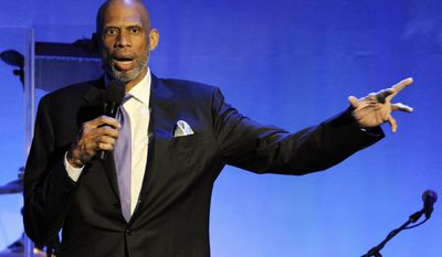 This Oct. 11, 2014, file photo shows retired basketball Hall of Famer Kareem Abdul-Jabbar addressing the audience during the 2014 Carousel of Hope Ball in Beverly Hills, Calif. (Photo by Chris Pizzello/Invision/AP,File)