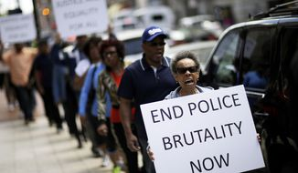 Protestors demonstrate outside the State Attorney's office calling for the continued investigation into the death of Freddie Gray, Wednesday, April 29, 2015, in Baltimore. Activists stressed that they will continue to press for answers in the case of Gray, the 25-year-old black man whose death from a spinal-cord injury under mysterious circumstances while in police custody set off the riots.  (AP Photo/David Goldman)