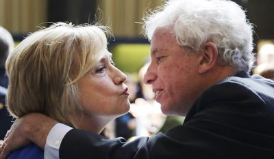 Hillary Rodham Clinton, left, a 2016 Democratic presidential contender, and Mark Green, a former New York mayoral candidate, exchange a kiss following her speech  at the David N. Dinkins Leadership and Public Policy Forum, Wednesday, April 29, 2015 in New York. (AP Photo/Mark Lennihan)