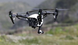 FILE - In this March 10, 2015 file photo, The Inspire 1, a drone manufactured by DJI, is flown in Davenport, Calif. Mexico published rules governing the use of drones on Wednesday, April 29, 2015, allowing people to operate the smallest drones in daylight without a permit but with safety rules. (AP Photo/Marcio Jose Sanchez, File)