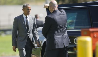 President Barack Obama walks to the presidential limousines after stepping off Marine One at Walter Reed National Military Medical Center in Bethesda, Md., Wednesday, April 29, 2015, for a visit with wounded military personnel. (AP Photo/Pablo Martinez Monsivais)