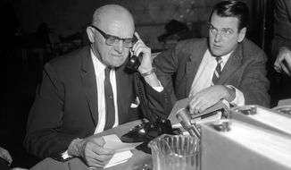 FILE - In a Dec. 2, 1963, file photo George Halas, left, the owner and coach of the Bears, and George Allen, defensive coach for the Bears, work at the football draft held at the Sheraton Hotel on Dec. 2, 1963, in Chicago.  The NFL Draft will be held in Chicago beginning Thursday, April 30, 2015. (Ed Wagner Sr./Chicago Tribune, via AP, File)   MANDATORY CREDIT CHICAGO TRIBUNE; CHICAGO SUN-TIMES OUT; DAILY HERALD OUT; NORTHWEST HERALD OUT; THE HERALD-NEWS OUT; DAILY CHRONICLE OUT; THE TIMES OF NORTHWEST INDIANA OUT; TV OUT; MAGS OUT; NO SALES