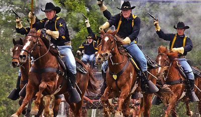 Gunpowder and dirt fly as the 1st Cavalry Division horse detachment make their traditional 'cavalry charge' to conclude the 1st Air Cavalry Brigade's color casing ceremony, March 25, 2009, at Cooper Field, Fort Hood, Texas. U.S. Army photo.
