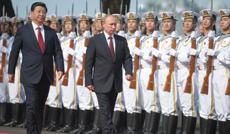 "Russian President Vladimir Putin and Chinese President Xi Jinping are said to have a budding ""bromance."" Their nations plan joint naval exercises in the Mediterranean and cooperation in China's proposed development bank. (Associated Press)"