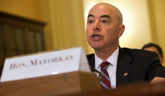 Alejandro Mayorkas, the deputy secretary whose previous tenure as the head of U.S. Citizenship and Immigration Services is under scrutiny, said when he did intervene in visa cases, it was to make sure his agency was following the law, not to give special treatment. (Associated Press)
