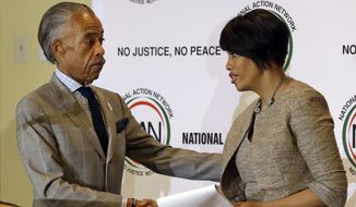 The Rev. Al Sharpton, left, shakes hands with Baltimore Mayor Stephanie Rawlings-Blake as she prepares to speak at a summit to address issues surrounding the death Freddie Gray and its aftermath at New Shiloh Baptist Church, Thursday, April 30, 2015, in Baltimore. Police completed their investigation into the death of  Gray a day earlier than planned Thursday and delivered it to the chief prosecutor in Baltimore, who pleaded for patience and peace while she decides whether to bring charges.  (AP Photo/Patrick Semansky)