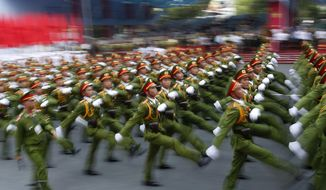 "Military personnel take part in a parade celebrating the 40th anniversary of the end of the Vietnam War which is also remembered as the ""Fall of Saigon,"" in Ho Chi Minh City, Vietnam, Thursday, April 30, 2015. (AP Photo/Dita Alangkara)"