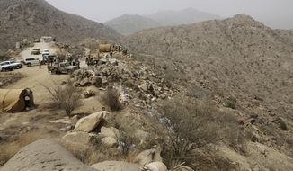 """Saudi soldiers work at the border with Yemen in Jazan, Saudi Arabia, in this Monday, April 20, 2015, file photo. A cross-border attack on Saudi Arabia by Yemeni rebel forces resulted in late-night clashes on Thursday, April 30, 2015, that left three Saudi soldiers and """"dozens"""" of Yemeni rebels dead, according to the Saudi Defense Ministry. (AP Photo/Hasan Jamali, File)"""