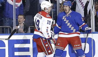 New York Rangers left wing Chris Kreider (20) celebrates in front of Washington Capitals center Nicklas Backstrom (19) after scoring a goal during the first period of Game 2 in the second round of the NHL Stanley Cup hockey playoffs Saturday, May 2, 2015, in New York. (AP Photo/Frank Franklin II)