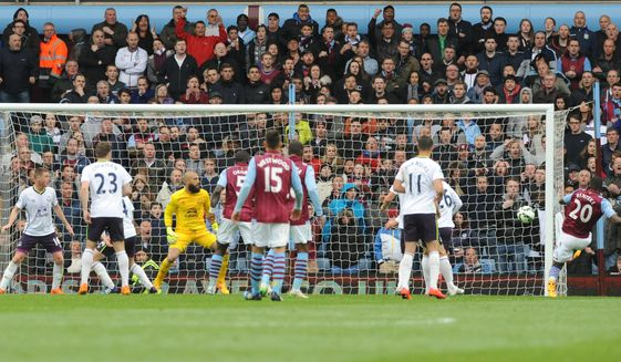 Villa's Christian Benteke, right, scores his second goal against Everton during the English Premier League soccer match between Aston Villa and Everton at Villa Park, Birmingham, England, Saturday, May 2, 2015. (AP Photo/Rui Vieira)