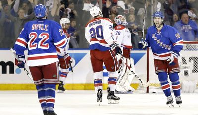 New York Rangers center Derick Brassard (16) celebrates with defenseman Dan Boyle (22) after Boyle score a goal on a power play against the Washington Capitals during the first period of Game 2 in the second round of the NHL Stanley Cup hockey playoffs Saturday, May 2, 2015, in New York. (AP Photo/Frank Franklin II)