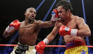 There were lots of angry people who were $100 lighter after watching Floyd Mayweather Jr.'s (left) victory Saturday night over Manny Pacquiao. (Associated Press)
