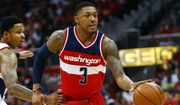 Washington Wizards guard Bradley Beal (3) drives past Atlanta Hawks guard Kent Bazemore (24) in the second half of an NBA second-round basketball payoff series game, Sunday, May 3, 2015, in Atlanta. Washington won 104-98. (AP Photo/John Bazemore) **FILE**