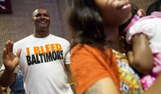 """John Barber, left, prays during a service at Southern Baptist Church Sunday, May 3, 2015, in Baltimore. A nearby senior center being built by the church was burned during the riots following Freddie Gray's funeral. Gov. Larry Hogan has called for a statewide """"Day Of Prayer And Peace"""" on Sunday after civil unrest rocked Baltimore. (AP Photo/David Goldman)"""