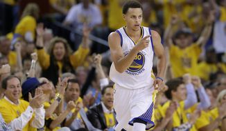 Golden State Warriors guard Stephen Curry (30) reacts after scoring against the Memphis Grizzlies during the first half of Game 1 in a second-round NBA playoff basketball series in Oakland, Calif., Sunday, May 3, 2015. (AP Photo/Marcio Jose Sanchez)