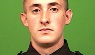 This undated photo released by the New York City Police Department shows officer Brian Moore. Moore, a New York City police officer shot in the head and critically injured while attempting to stop a man suspected of carrying a gun is recovering following brain surgery. Detectives were still investigating Sunday, May 3, 2015, after arresting 35-year-old Demitrius Blackwell in the shooting.  (New York City Police Department via AP)