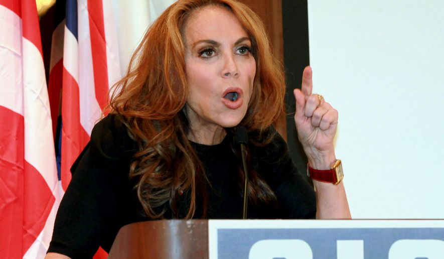 """FILE - In this Sept. 11, 2012 file photo, Pamela Geller, head of the American Freedom Defense Initiative, speaks at a conference in New York. The Prophet Muhammad cartoon contest that exploded in violence in Texas on Sunday, May 3, 2015, was organized by Geller, a New Yorker who rails against Islam with such ferocity that one of the nation's top civil rights groups lists her in its """"extremist files."""" (AP Photo/David Karp, File)"""