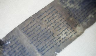 This Friday, May 10, 2013, file photo shows the world's oldest complete copy of the Ten Commandments, written on one of the Dead Sea Scrolls in Jerusalem. The manuscript is on rare display at Israel's national museum in an exhibit of objects from pivotal moments in the history of civilization. (AP Photo/Dan Balilty, File)