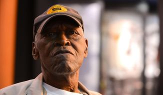 Therman White is photographed in the Jesse Owens Memorial Museum, April 28, 2015, in Oakville, Ala. White grew up with obstacles: his race, poverty and Jim Crow laws designed to keep blacks separate and unequal. World War II changed all that.  White served in the U.S. Navy in ammunition depots in Yorktown, Va., and Asbury Park, N.J. during the war.  He said when he raised his hand to join the Navy he stepped into the middle class, a move that changed his life.  (Gary Cosby Jr./The Decatur Daily via AP) MANDATORY CREDIT