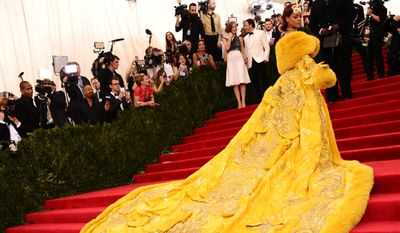 """Rihanna arrives at The Metropolitan Museum of Art's Costume Institute benefit gala celebrating """"China: Through the Looking Glass"""" on Monday, May 4, 2015, in New York. (Photo by Charles Sykes/Invision/AP)"""