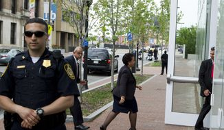 Attorney General Loretta Lynch shakes hands with students before meeting with members of Congress and faith leaders at the University of Baltimore on Tuesday, May 5, 2015, in Baltimore.  The FBI and the Justice Department are investigating Gray's death for potential civil rights violations. (AP Photo/Jose Luis Magana, Pool)
