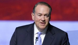 Former Arkansas Gov. Mike Huckabee speaks to supporters in Hope, Ark., as he announces that he is seeking the Republican nomination in the 2016 race for president in this May 5, 2015, photo. (AP Photo/Danny Johnston)