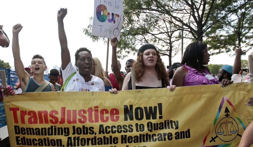 In this June 27, 2014, file photo, people march during the 10th annual Trans Day of Action in New York. (AP Photo/Frank Franklin II, File)