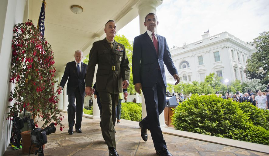 President Barack Obama walks with Marine Gen. Joseph Dunford Jr., his nominee to be the next chairman of the Joint Chiefs of Staff, after speaking in the Rose Garden of the White House in Washington, Tuesday, May 5, 2015. Obama chose the widely respected, combat-hardened commander who led the Afghanistan war coalition during a key transitional period during 2013-2014 to succeed Army Gen. Martin Dempsey. Walking behind them is Vice President Joe Biden. (AP Photo/Pablo Martinez Monsivais)