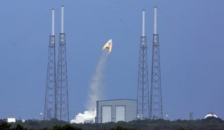 SpaceX's Dragon capsule launches, Wednesday, May 6, 2015, from Cape Canaveral, Fla. SpaceX fired the mock-up capsule to test the new, super-streamlined launch escape system for astronauts. (Red Huber/Orlando Sentinel via AP)