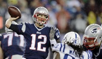 New England Patriots quarterback Tom Brady (12) passes against the Indianapolis Colts during the second half of the NFL football AFC Championship game in Foxborough, Mass., in this Jan. 18, 2015, file photo. (AP Photo/Charles Krupa, File)