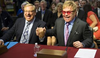 Musician Sir Elton John, right, greets Dr. Rick Warren on Capitol Hill in Washington, Wednesday, May 6, 2015, prior to testifying before the Senate State, Foreign Operations and Related Programs subcommittee in support of U.S. funding for global HIV/AIDS treatment. (AP Photo/Evan Vucci)