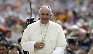 Pope Francis arrives for his weekly general audience in St. Peter's Square at the Vatican Wednesday, May 6, 2015. (AP Photo/Gregorio Borgia)
