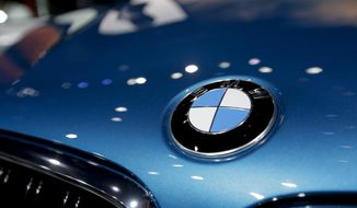 In this Nov. 19, 2014, file photo, BMW introduces the X6 M during the Los Angeles Auto Show in Los Angeles. (AP Photo/Chris Carlson, File)