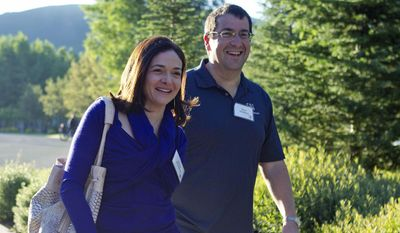 In this July 6, 2011 photo, Facebook COO Sheryl Sandberg, left, and her husband, David Goldberg, CEO of SurveyMonkey, arrive at the Sun Valley Inn for the Allen and Co. Sun Valley Conference, in Sun Valley, Idaho. Goldberg died in an accident while exercising at a Mexican vacation resort on Friday, May 1, 2015. (AP Photo/Julie Jacobson, File)