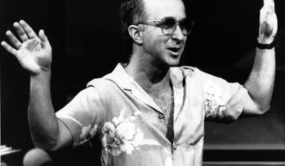 """FILE - In this July 28, 1986 file photo, bandleader Paul Shaffer directs his band during a rehearsal for """"Late Night with David Letterman"""" in New York. Shaffer, now 65, has been the gravel-voiced sidekick of David Letterman since 1982. Letterman is retiring on May 20. (AP Photo/Susan Ragan, File)"""