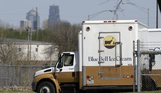Blue Bell delivery trucks are parked at the creamery's location in Kansas City, Kansas, in this April 10, 2015, file photo. Blue Bell ice cream had evidence of listeria bacteria in its Oklahoma manufacturing plant as far back as March 2013, a government investigation released Thursday says. (AP Photo/Orlin Wagner, File)