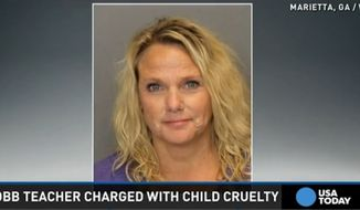 "Mary Katherine Pursley, a special education teacher at Mt. Bethel Elementary, has been charged with cruelty to children after she allegedly put an autistic boy in a trash can and called him ""Oscar the Grouch."" (USA Today)"