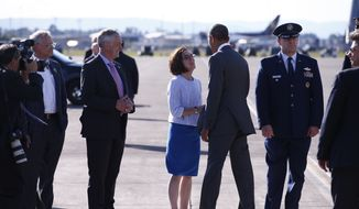President Obama shakes hands with Oregon Gov. Kate Brown as he arrives at the Portland International Airport, Thursday, May 7, 2015, in Portland, Ore. Obama arrived in Portland for a two-day visit to raise money for Democrats and to highlight trade. (Bruce Ely/The Oregonian via AP)