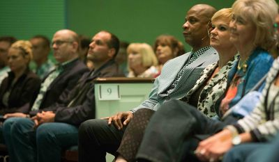 In this April 24, 2015, photo former baseball player Darryl Strawberry and his wife, Tracy, second and third from right, sit among the crowd before speaking in Bear, Del. His promising career was derailed by drug addiction, domestic violence, tax woes and a bout with a cancer. Mr. Strawberry is on a new path these days, speaking with his wife from the pulpit and spreading his story of redemption.  (AP Photo/Suchat Pederson)