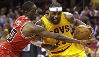 Cleveland Cavaliers forward LeBron James (23) drives against Chicago Bulls forward Tony Snell (20) during the second half of Game 2 in a second-round NBA basketball playoff series Wednesday, May 6, 2015, in Cleveland. The Cavaliers won 106-91. (AP Photo/Tony Dejak)