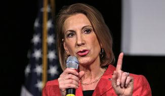 Republican presidential candidate Carly Fiorina, the former Hewlett-Packard chief executive, gestures during her address at an N.H. High Tech Council event in Manchester, N.H., Friday, May 8, 2015. (AP Photo/Charles Krupa)