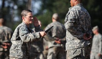 U.S. Army Soldiers conduct combatives training during the Ranger Course on Ft. Benning, GA., April 20, 2015. Soldiers attend Ranger school to learn additional leadership and small unit technical and tactical skills in a physically and mentally demanding, combat simulated environment. (U.S. Army photo by Pfc. Antonio Lewis/Released) ** FILE **